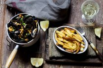 Moules-frites, blue mussel and french fries, white wine — Stock Photo