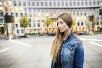 Portrait of young woman in the city — Stock Photo