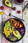 Quinoa veggie bowl of avocado, Edamame, tomatoes, corn, carrots, red cabbage and pomegranate seed — Stock Photo
