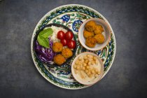 Couscous sweet potato falafel bowl with red cabbage, tomato, mint and hummus — Stock Photo