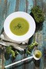Broccoli cream soup with cress — Stock Photo
