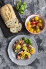 Bruschetta, ciabatta with multi-coloured tomatoes and basil — Stock Photo