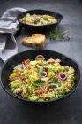 Tabbouleh made of couscous, tomatoes, red onions, cucumber, parsley and mint — стоковое фото