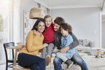 Portrait of happy family with two kids at home — Stock Photo