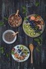 Superfood smoothie bowl with chia seeds, blueberries, nectarine, kiwi and chocolate granola — Stock Photo