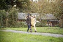 Two happy women walking in rural landscape — Stock Photo