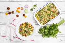 Couscous salad with tomatoes, cucumber, parsley and mint — Stock Photo