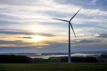 Germany, Hesse, Taunus, wind wheel at the sunset — Stock Photo