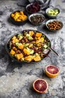 Superfood salad, avocado, beetroot, roasted chickpea, sweet potatoe, beluga lentil and blood orange — Stock Photo