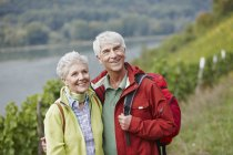 Germany, Rheingau, happy senior couple hiking — стоковое фото