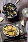 Moules-frites, blue mussel and french fries, white wine — Photo de stock