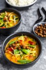 Red curry in bowls and roasted chickpeas — Photo de stock