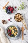 Buddha bowl of green chia pudding with slices of banana, blueberries, raspberries and walnuts — стоковое фото
