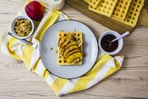 Waffle garnished with nectarine, walnuts and maple sirup — Stock Photo