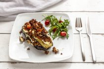 Aubergine lasagne on plate, rucola and tomato, vegetarian — Stock Photo