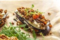 Aubergine lasagne on baking paper, vegetarian — Stock Photo