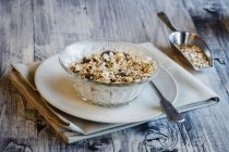 Glass bowl of homemade granola — Stockfoto