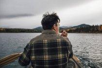 Canada, British Columbia, man in canoe on Boya Lake — Stock Photo