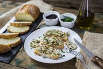 Bruschetta and various ingredients, mushroom, chives, olive oil — Stock Photo
