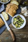 Bruschetta and various ingredients, bread, zucchini and garlic — Stock Photo