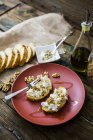 Bruschetta and various ingredients, ricotta cheese, nuts, olive oil, bread — Foto stock