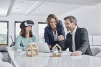 Business people having a meeting in office with VR glasses, laptop and architectural models — Stock Photo