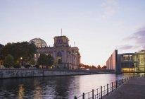 Germany, Berlin, Regierungsviertel, Reichstag building und Paul-Loebe-Building at Spree river — Stock Photo