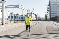 Young athlete jogging in the city — Stock Photo