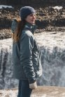 Iceland, woman standing at Dettifoss waterfall — Foto stock