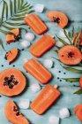 Homemade papaya ice lollies — Stock Photo