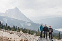 Canada, British Columbia, Yoho National Park, portrait of three hikers at Mount Burgess — Stock Photo