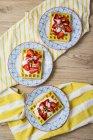 Three plates of waffles garnished with strawberries, Greek yogurt and almonds — Stock Photo