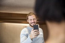 Portrait of smiling man taking picture of his girlfriend — Stock Photo