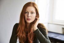 Portrait of serious redheaded woman — Stock Photo