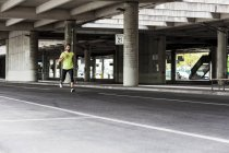 Man running on a street — Stock Photo