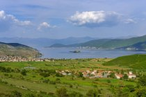 Albania, Prespa National Park, Lake Prespa with Maligrad Island and villages Lejthize and Liqenas, Greece and Macedonia in the background — Stock Photo
