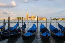 Italy, Venice, Gondolas at San Giorgio Maggiore in the evening — Stock Photo