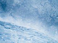 Immagine full frame di spruzzi d'acqua blu — Foto stock