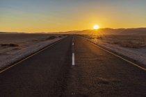 Africa, Namibia, Namib desert, Naukluft National Park, empty road at sunset — Stock Photo