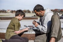 Father and son repairing drone — Stock Photo