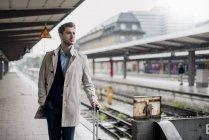 Businessman waiting at the platform — Stock Photo