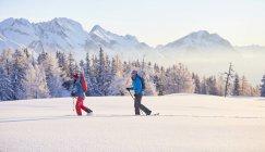 Austria, Tyrol, couple snowshoeing — Stock Photo