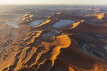 Africa, Namibia, Namib desert, Namib-Naukluft National Park, Aerial view of desert dunes, Dead Vlei and 'Big Daddy' in the morning light — Stock Photo
