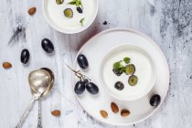 Ajo Blanco, white gazpacho, spanish cold soup, almonds and blue grapes, overhead view — Stock Photo