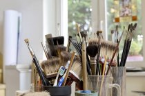 Assortment of brushes in a workshop — Stock Photo