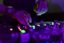 DJ working on mixing board — Stock Photo