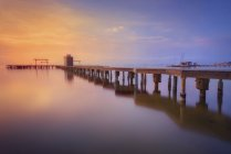 Spain, La Manga del Mar Menor, pier at sunrise — Stock Photo