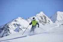 Austria, Tyrol, Kuehtai, man skiing in winter landscape — Stock Photo