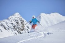 Austria, Tyrol, Kuehtai, woman skiing in winter landscape — Stock Photo