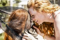 Happy redheaded mother and daughter in net — Stock Photo
